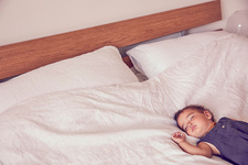 Female toddler, sleeping on bed