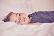 Female toddler, sleeping on bed, close-up