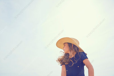 Young girl, outdoors, looking away, low angle view