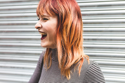 Portrait of a young woman with dyed hair, laughing