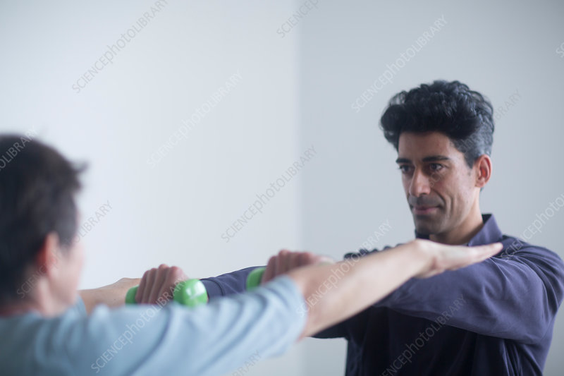 Physiotherapist examining patient
