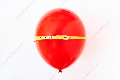 Red balloon, conceptual image of bloated stomach