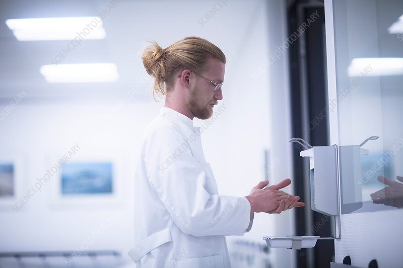 Male doctor using hand sanitiser