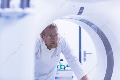 Radiologist with MRI machine