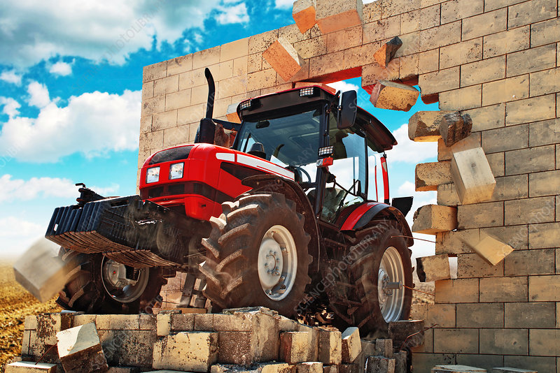 Tractor breaking through wall, conceptual image