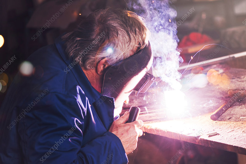 Welder in workshop