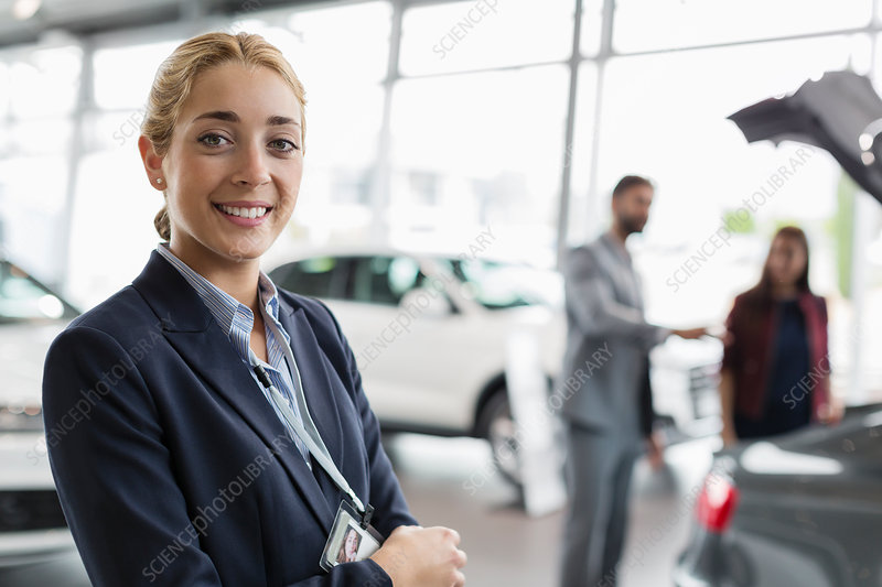 Portrait car saleswoman in showroom