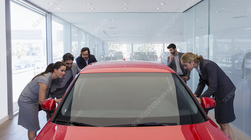 Customers looking at car in showroom