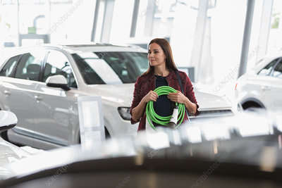 Female customer carrying hybrid charging cord