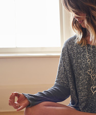 Serene woman meditating in lotus position