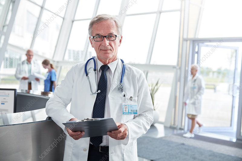 Portrait senior doctor in hospital lobby