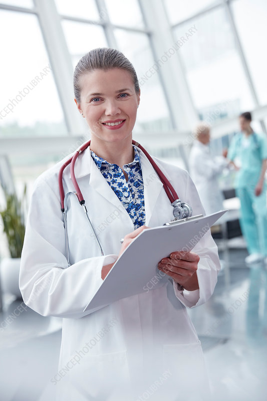 Portrait doctor with clipboard in hospital