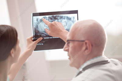 Doctor and nurse reviewing x-ray in hospital