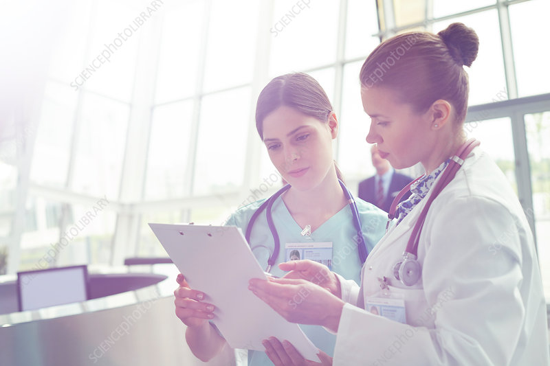 Female doctor and nurse consulting