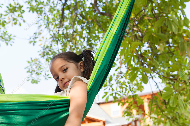 Portrait girl in green hammock