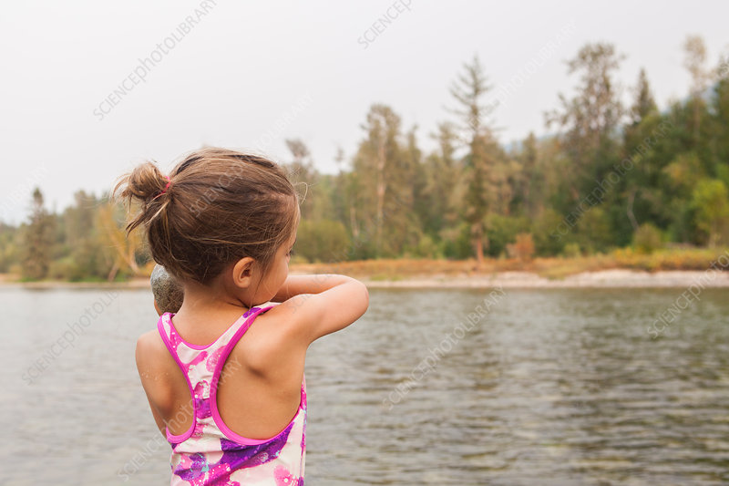 Girl in bathing suit at lake