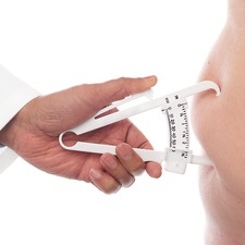 Doctor measuring body fat