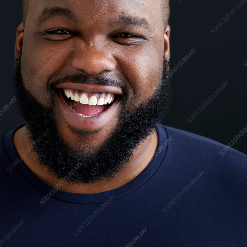 Portrait of man laughing and smiling