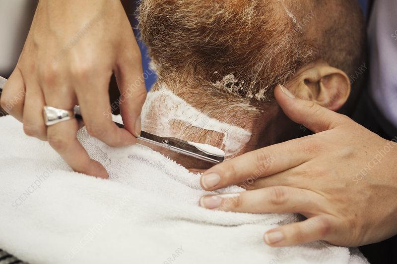 Barber wet shaving customer