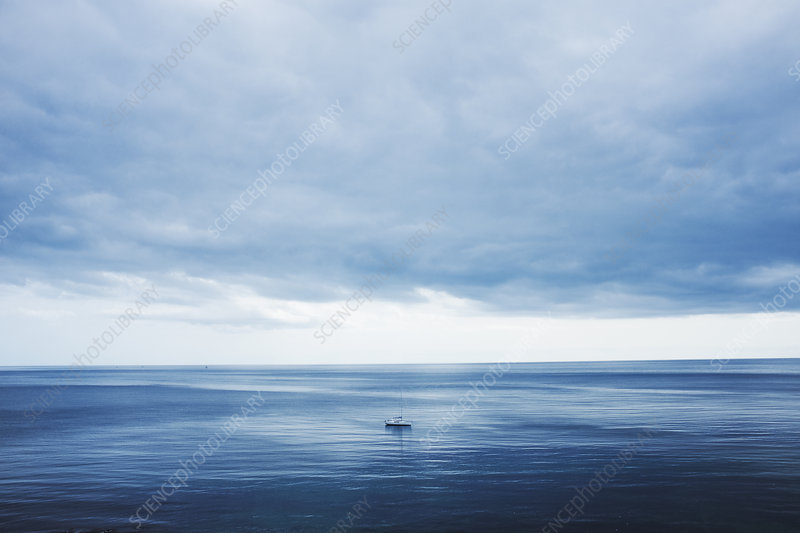 Calm sea view with small yacht