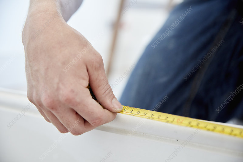 Man using a steel measuring tape