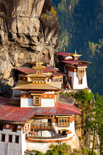 Himalayan Buddhist sacred site complex on vertical rock face