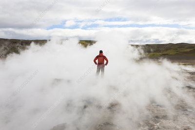Woman standing by geothermal pools