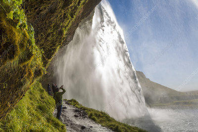 Waterfall cascading over a sheer cliff