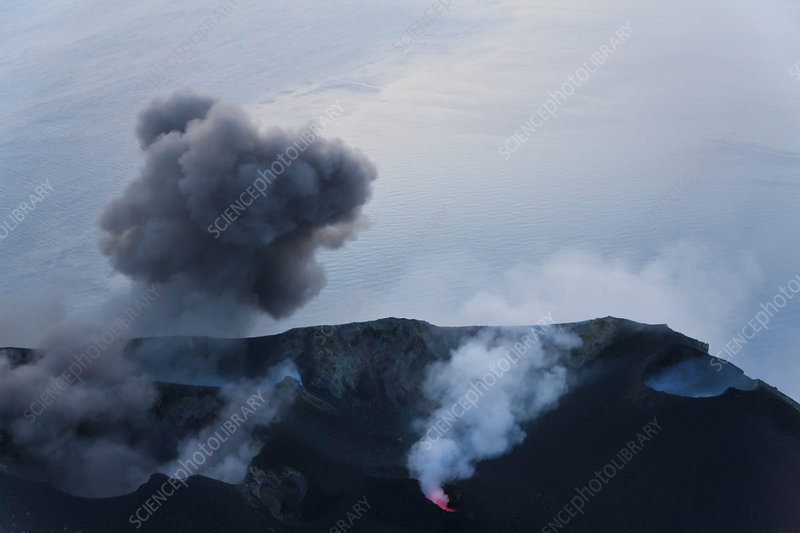 Plumes of smoke and lava emanating from a volcano
