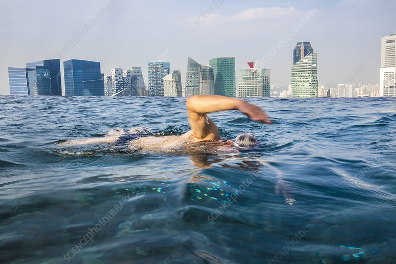 Man swimming in rooftop pool