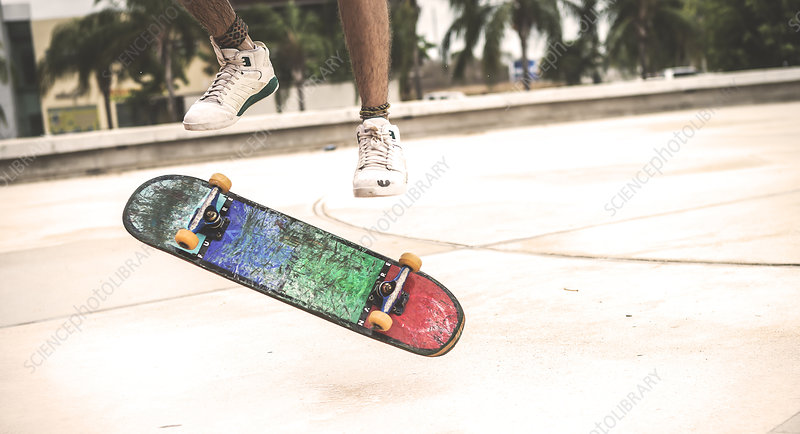 Close up skateboard spinning in mid air