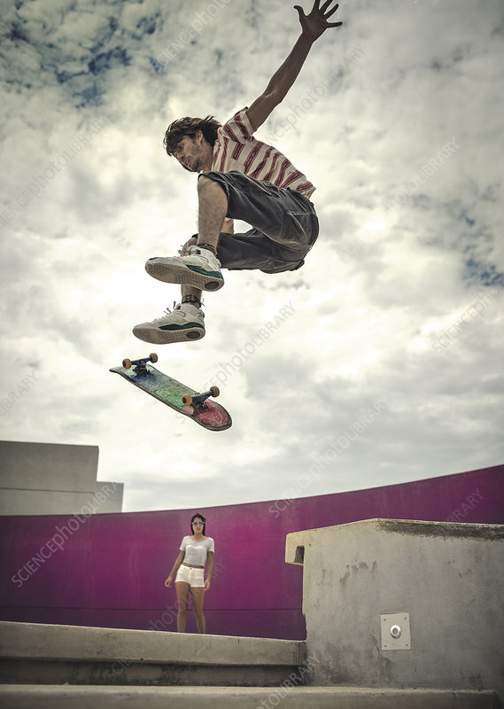A low angle view of a skateboarder jumping in mid air