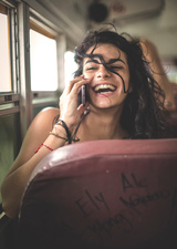 Young woman on bus using mobile phone