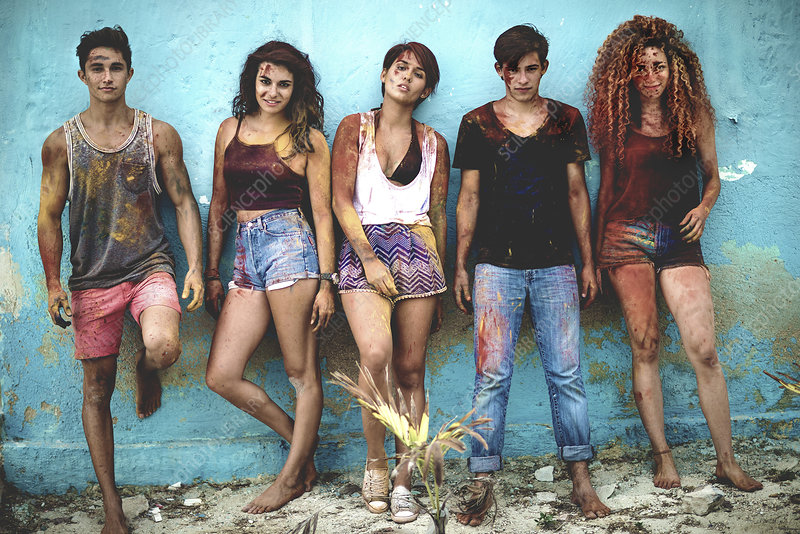 Five young people covered in paint