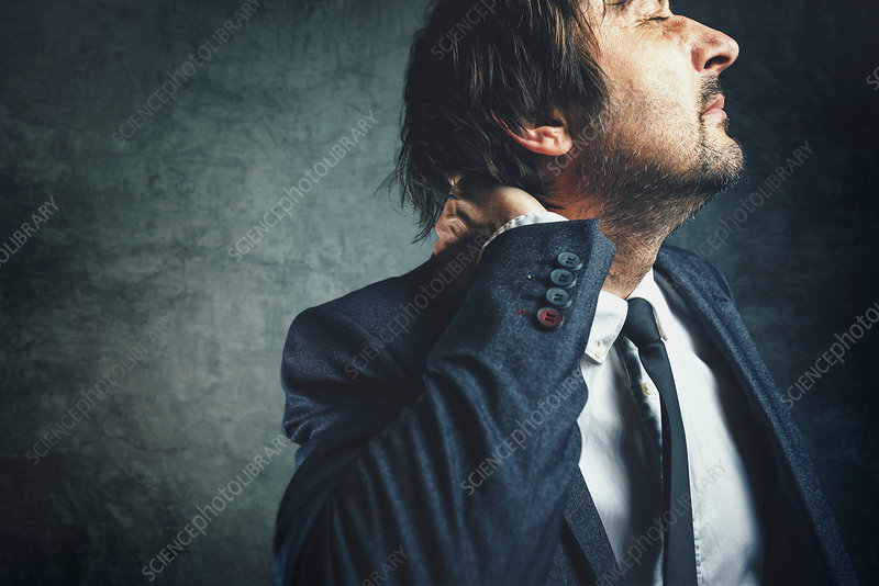 Businessman with neck pain