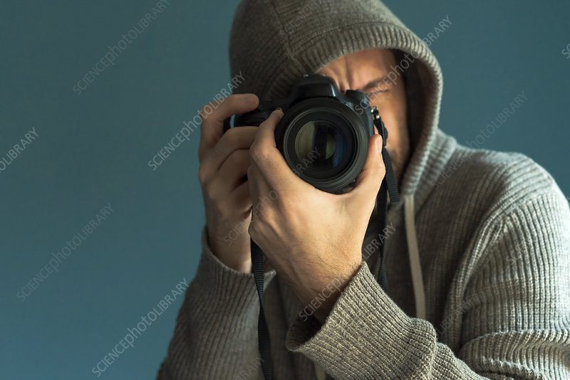 Photographer holding full frame sensor DSLR camera
