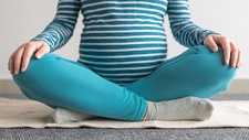 Pregnant woman practicing yoga