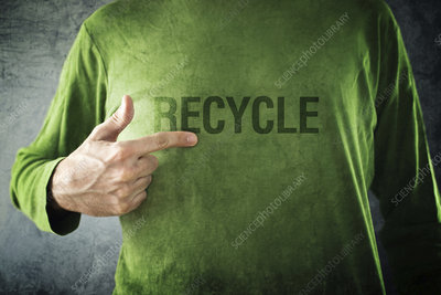 Man pointing to recycle printed on his shirt
