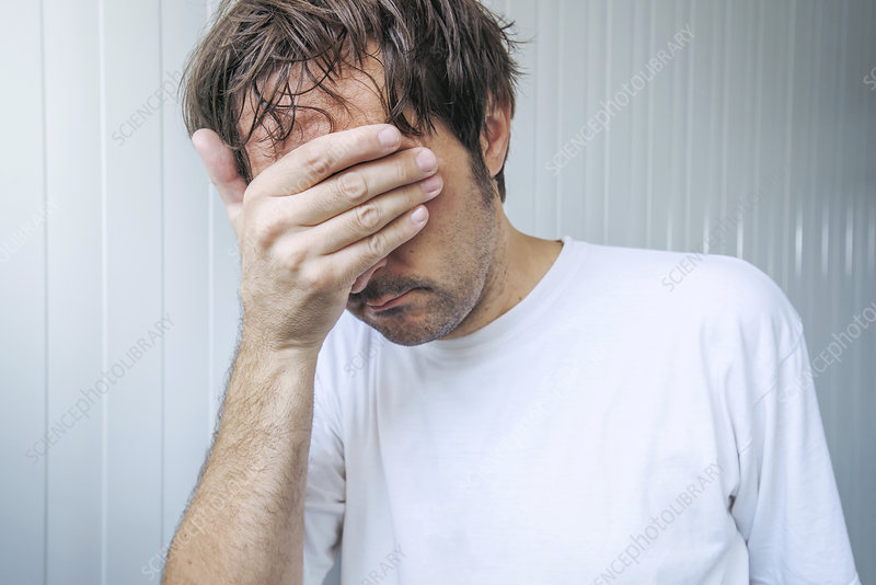 Man covering face and crying