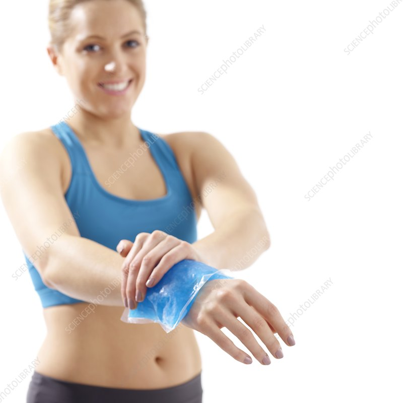 Woman with ice pack on her wrist