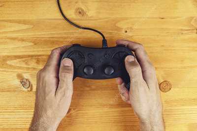 Hands using video game controller
