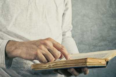 Man reading old book