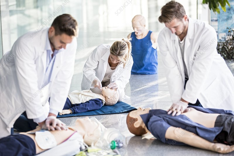 Doctors undertaking CPR training