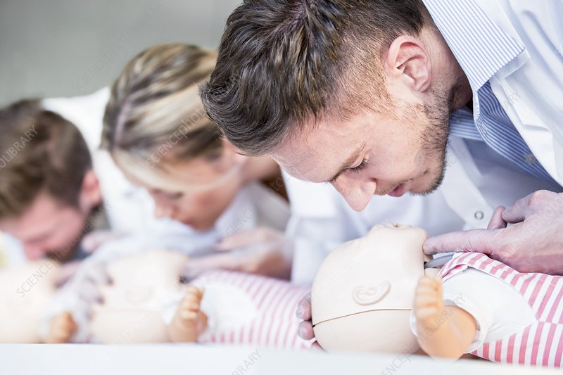 Doctors practising infant CPR