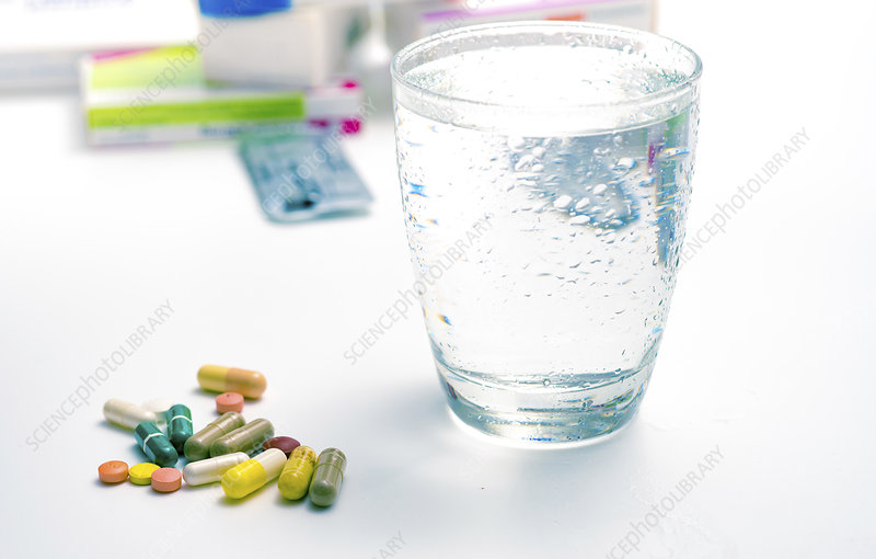 Medicines and glass of water