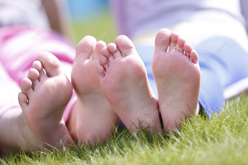Girls bare feet on grass
