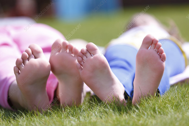 Girls' bare feet on grass
