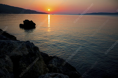 Sunset over calm sea