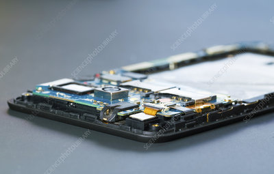 Disassembled mobile phone in the service centre with interna