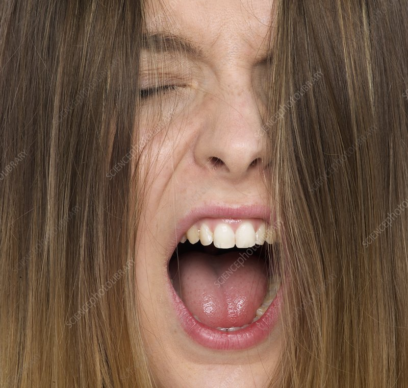 Woman shouting with mouth open